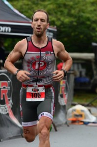 Fitness professional and athlete Nathan Nowak racing for team podium multisport at the peachtree city sprint triathlon