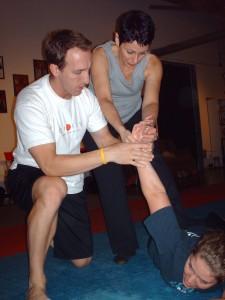 Nathan Nowak demonstrating women's self defense at Trinity Fitness Are You Prepared self defense seminar