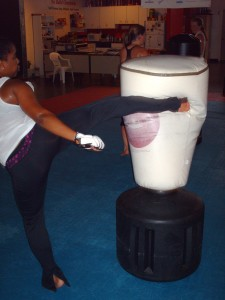 Trinity Fitness Tae Kwon Do team member demonstrating a round kick during an are you prepared? women's self defense seminar