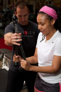 Fitness professional Nathan Nowak women's fitness and nutrition expert training clients at Trinity Fitness in Atlanta Georgia